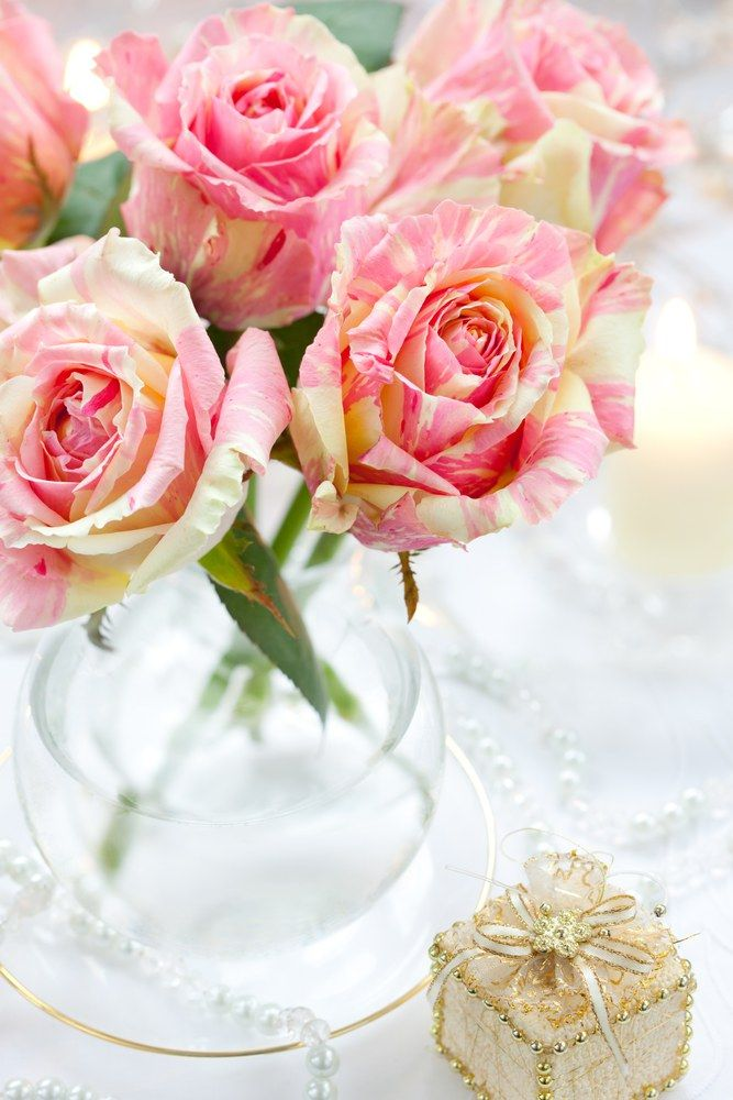Bouquet of pink roses in vase,candle and little gift box