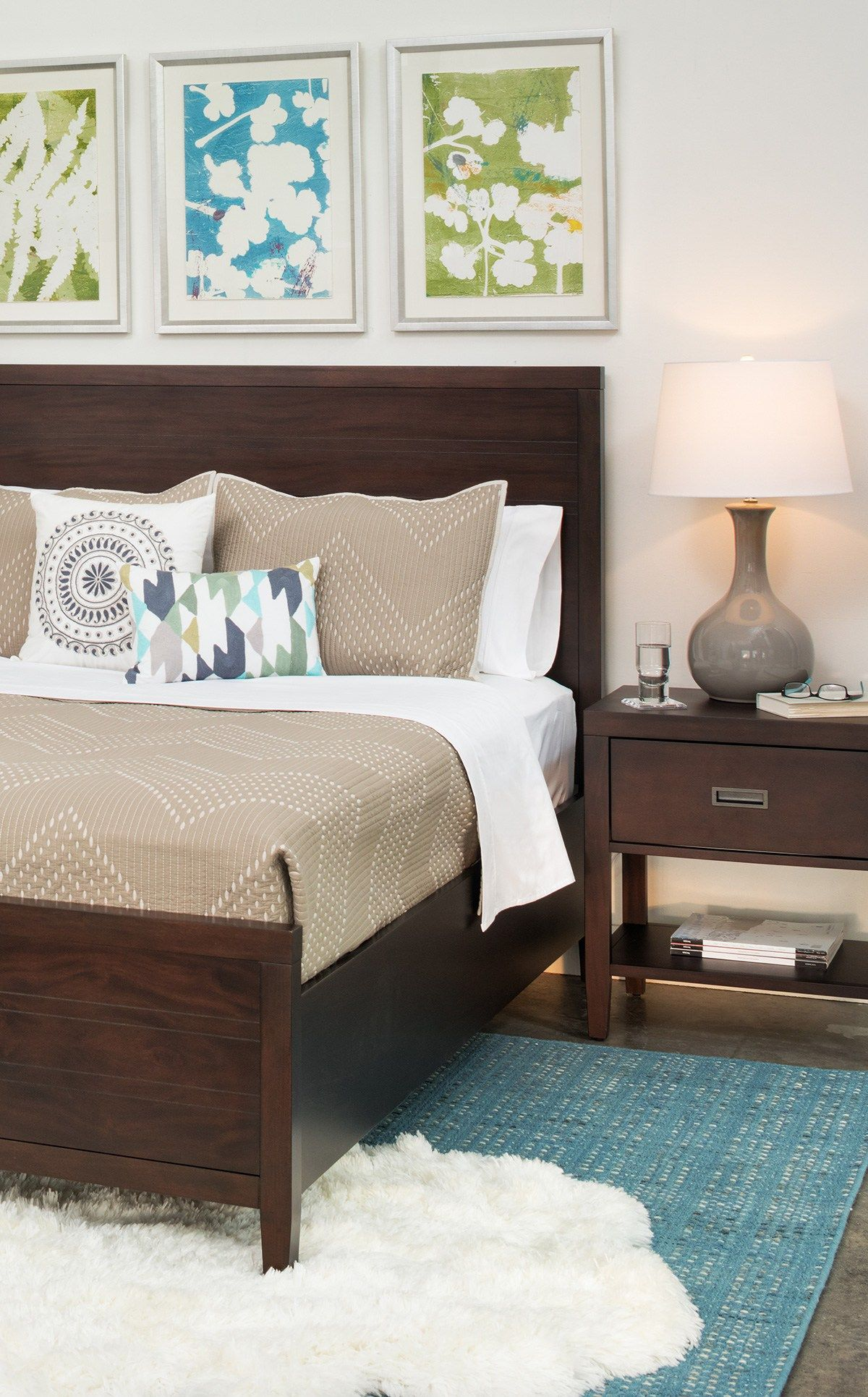 Master Bedroom With Layered Area Rugs For Added Comfort