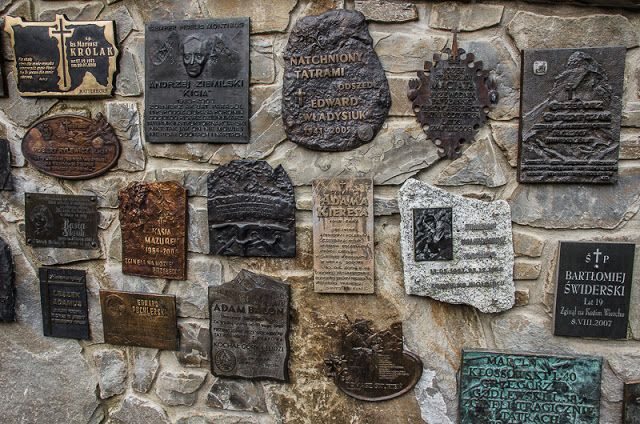 The Wiktori Church - Zakopane:  Around the church is located one of the several symbolic cemeteries in the Tatras. This is the place where commemorative plaques of those who died in the mountains or tied up their lives with the mountains have been placed.