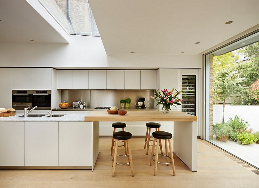 Elegant White Scandinavian Style Kitchen With Skylight Marble And Wood Accent Surfaces Scandinavian Kitchen Design Modern Kitchen Kitchen Inspirations