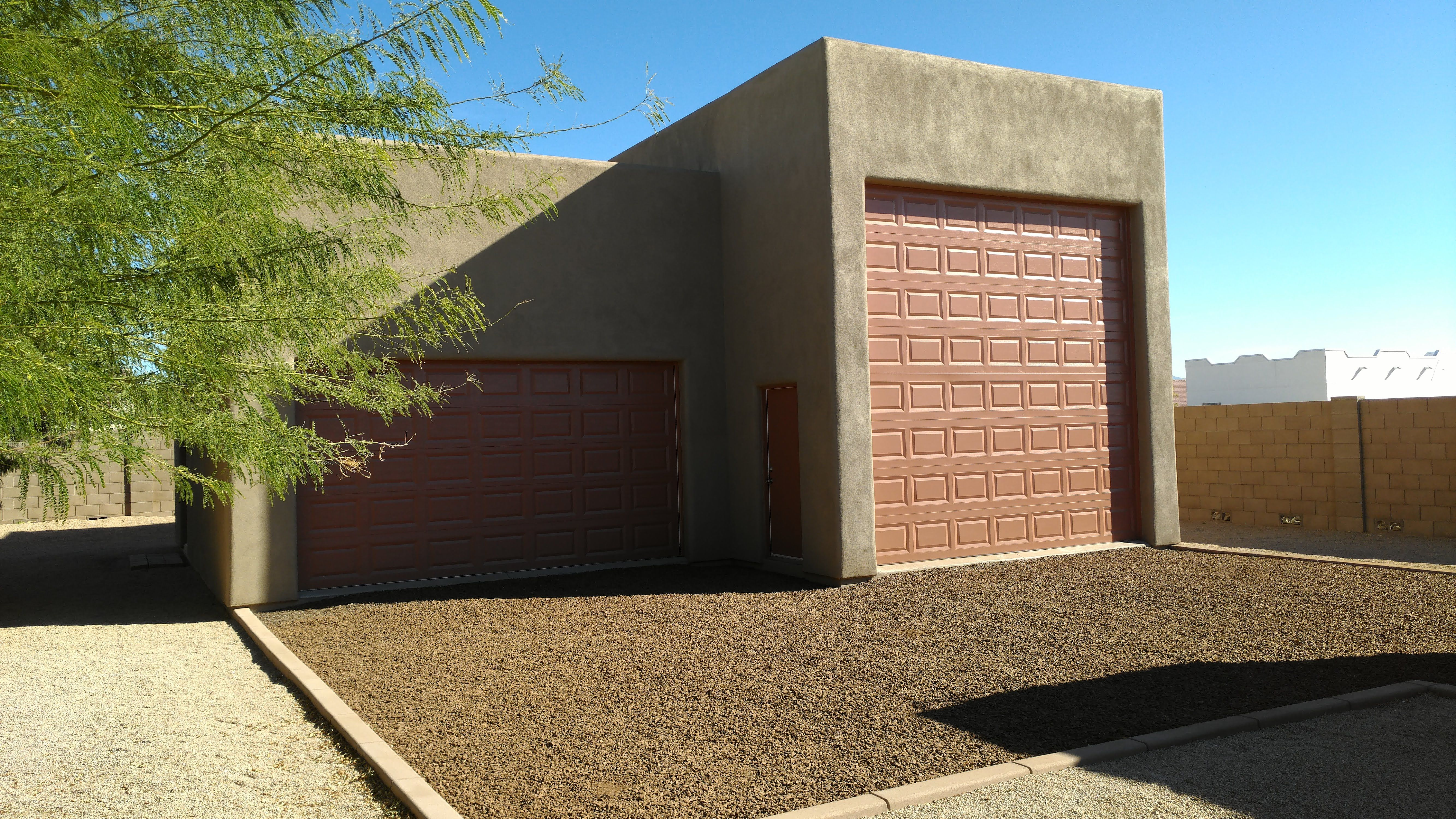 If You Ve Got Southwestern Style We Ve Got The Garage For You The Stucco Exterior And Color Scheme Were Stucco Exterior Shed Construction Build Your Own Shed