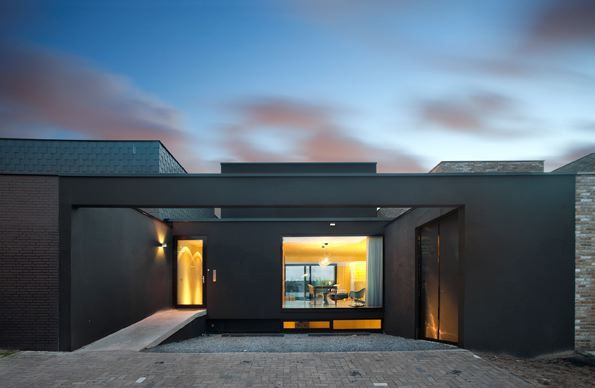 Three Floor House Design Disguised as a SingleStorey Modern