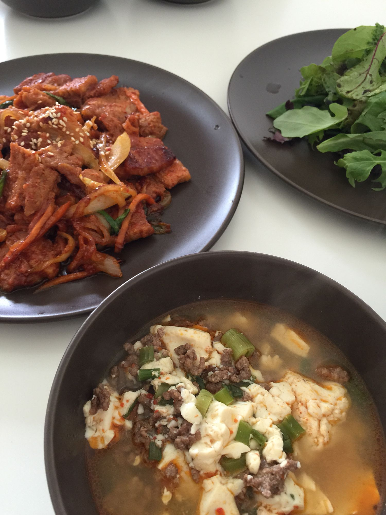 Beef soft tofu soup with spicy sautéed pork belly! Cook