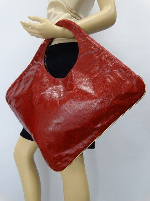 Just in! Arza Red Distressed Leather Diamond Shoulder Bag. Save up to 70% off retail at www.ShopKarma.com. High end pre owned designer bags, clothing, shoes and accessories. #karmacouture #shopkarma #upscaleresale #shopresale #consignment #designer #fashion #style #azra #handbags