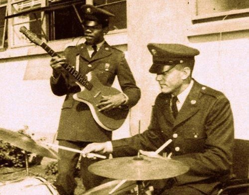 Private James Marshall Hendrix, aka Jimmy Hendrix of the 101 Airborne at Fort Campbell Kentucky playing a guitar, 1962.