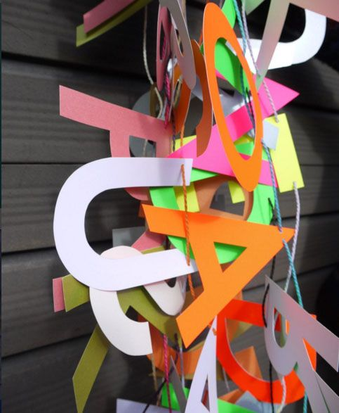 Luxury handmade paper decorations We try to have #colour  & #texture in most of our images so for day 26 of the @joannehawker#MarchMeetTheMaker challenge a candid pic of all our new letter banners scooped up together in a tangle