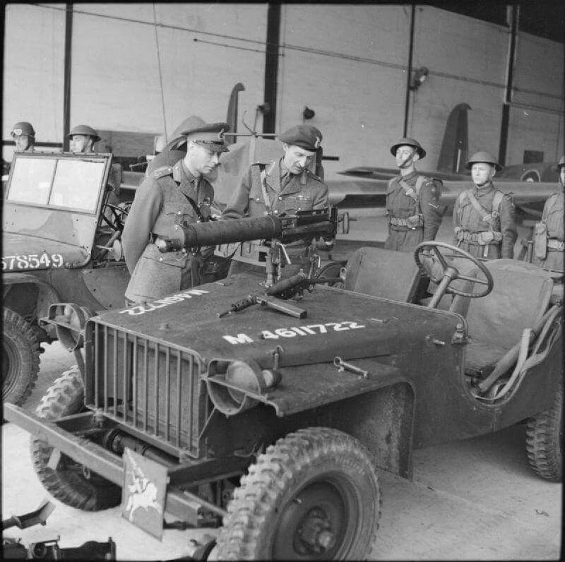 King George VI inspects an airborne jeep fitted with a Vickers machine gun during a visit to the airborne forces in Southern Command, 21 May 1942. With him is Major-General Frederick Browning, GOC of the 1st Airborne Division.
