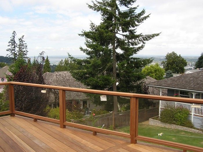Glass railing for decks and porches railings pinterest for Garden decking banister