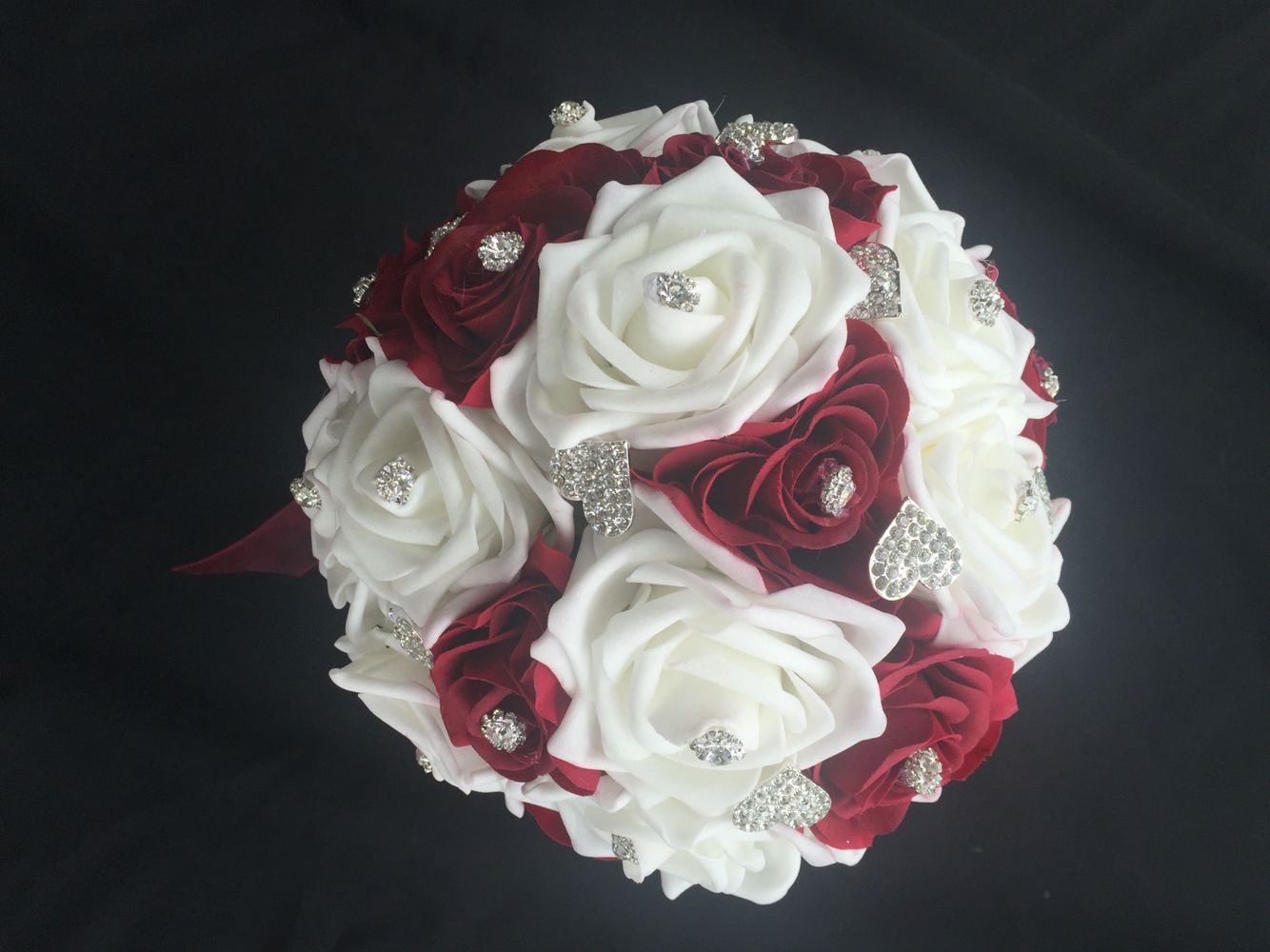 A Blend Of White And Deep Red Real Touch Roses With A Few Brooches
