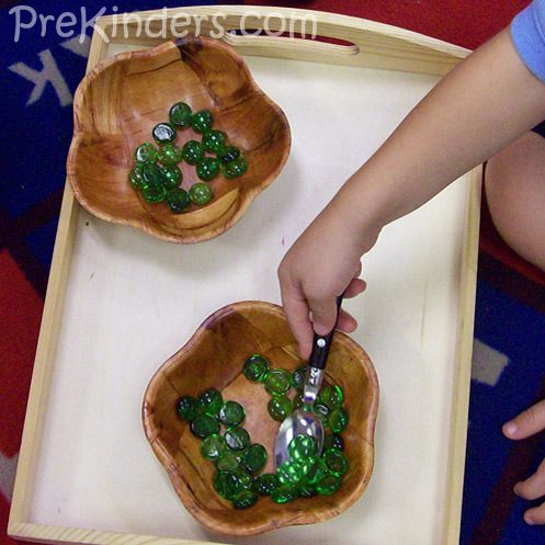 Fine motor - move marbles from left bowl to right bowl using spoon- add to dramatic play area