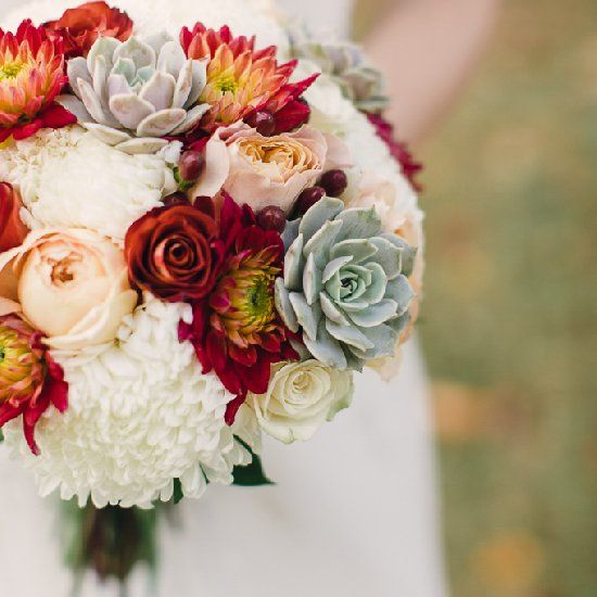 Deep reds and succulents form the perfect bouquet for a rustic, elegant fall wedding in Memphis. By Amy Hutchinson Photography.