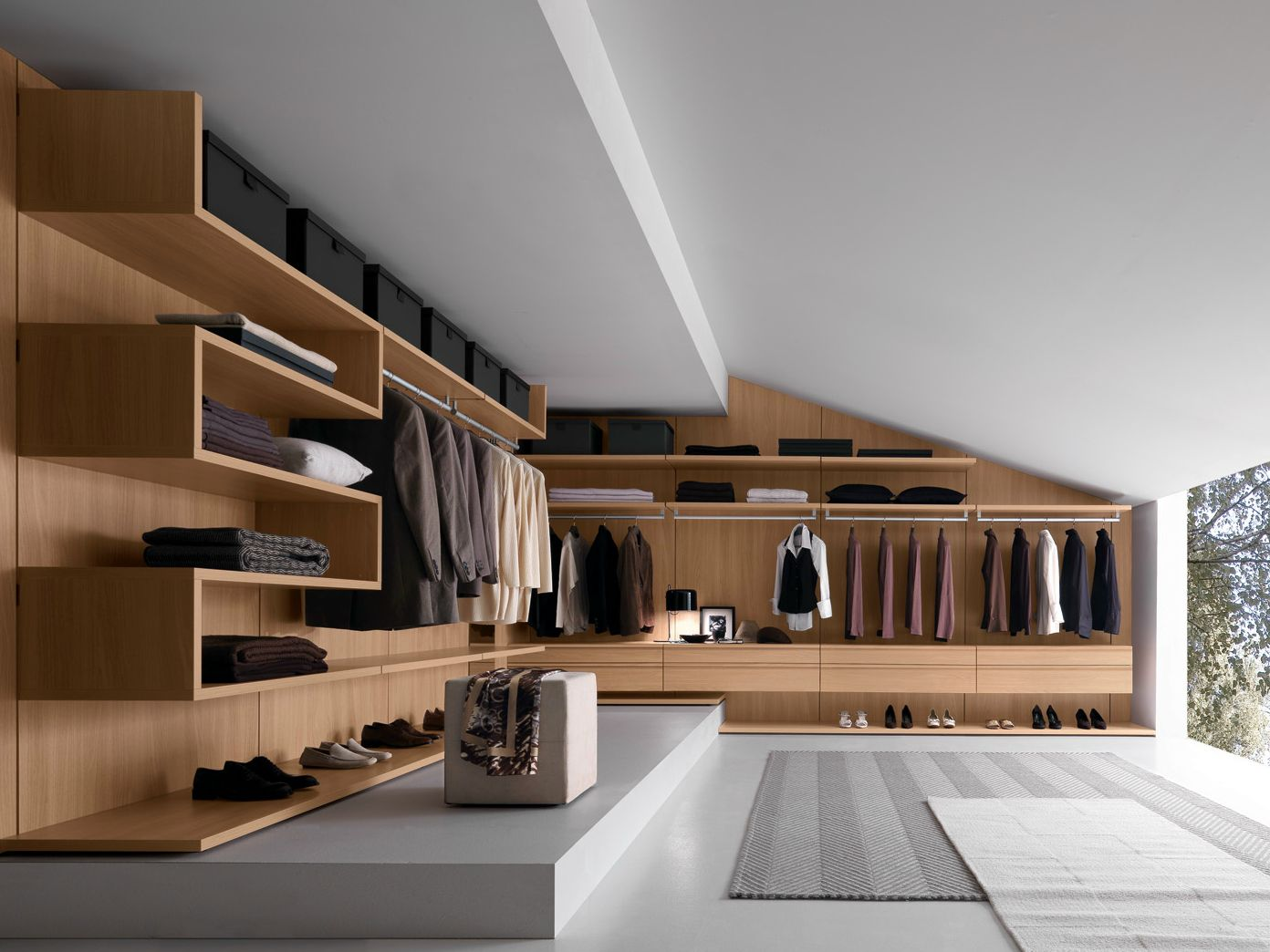 Modern Luxurious Open Space Grey Walk In Closet With Stunning Wall Mounted  Wooden Wardrobe In Cool Design With Nice Grey Carpet And Beautiful Outdoor  View.
