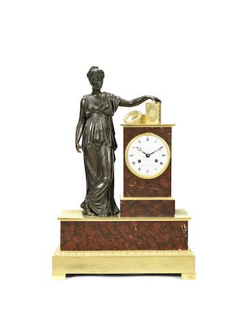 An early 19th century and later gilt and patinated bronze and rouge marble figural mantel clock the dial signed Boileau a Paris