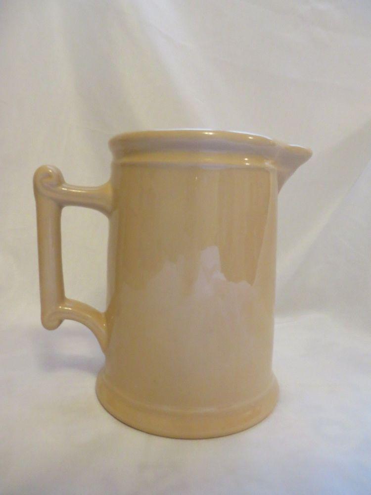 Vintage restaurant hotel water pitcher tan color D-style handle McNicol Roloc