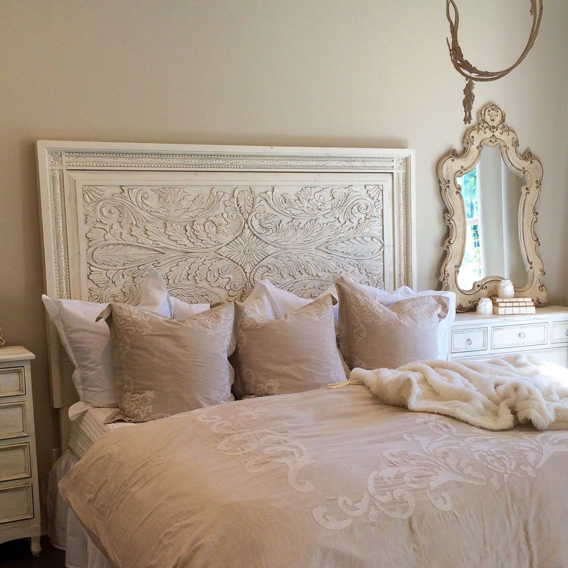 Unique carved white king headboard. French country