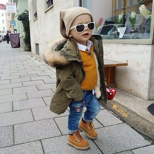 Little Boy Wearing A Casual Winter Outfit With Timberland