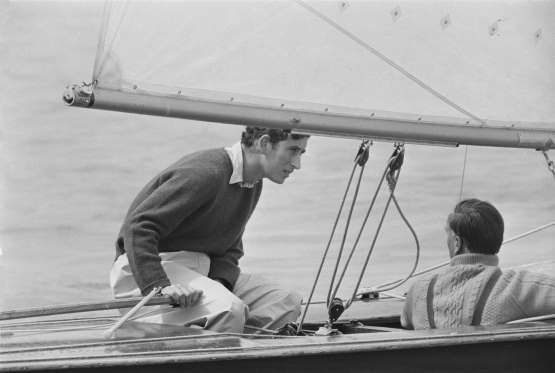 1971 -- At the helm of his yacht 'Coweslip' off the Isle of Wight during a regatta. - Getty