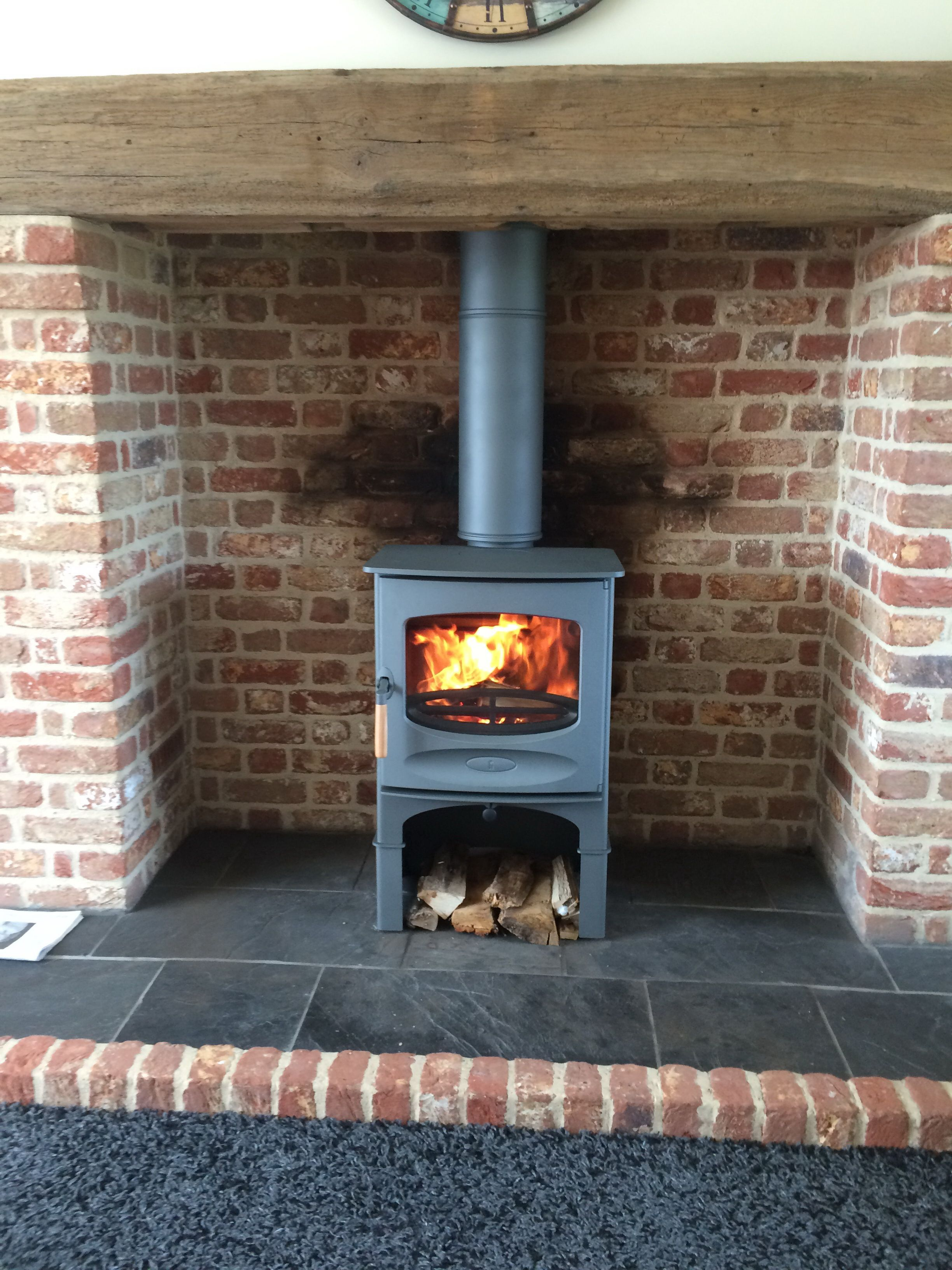 Charnwood C5 with log store stand in gunmetal finish. Placed on ...
