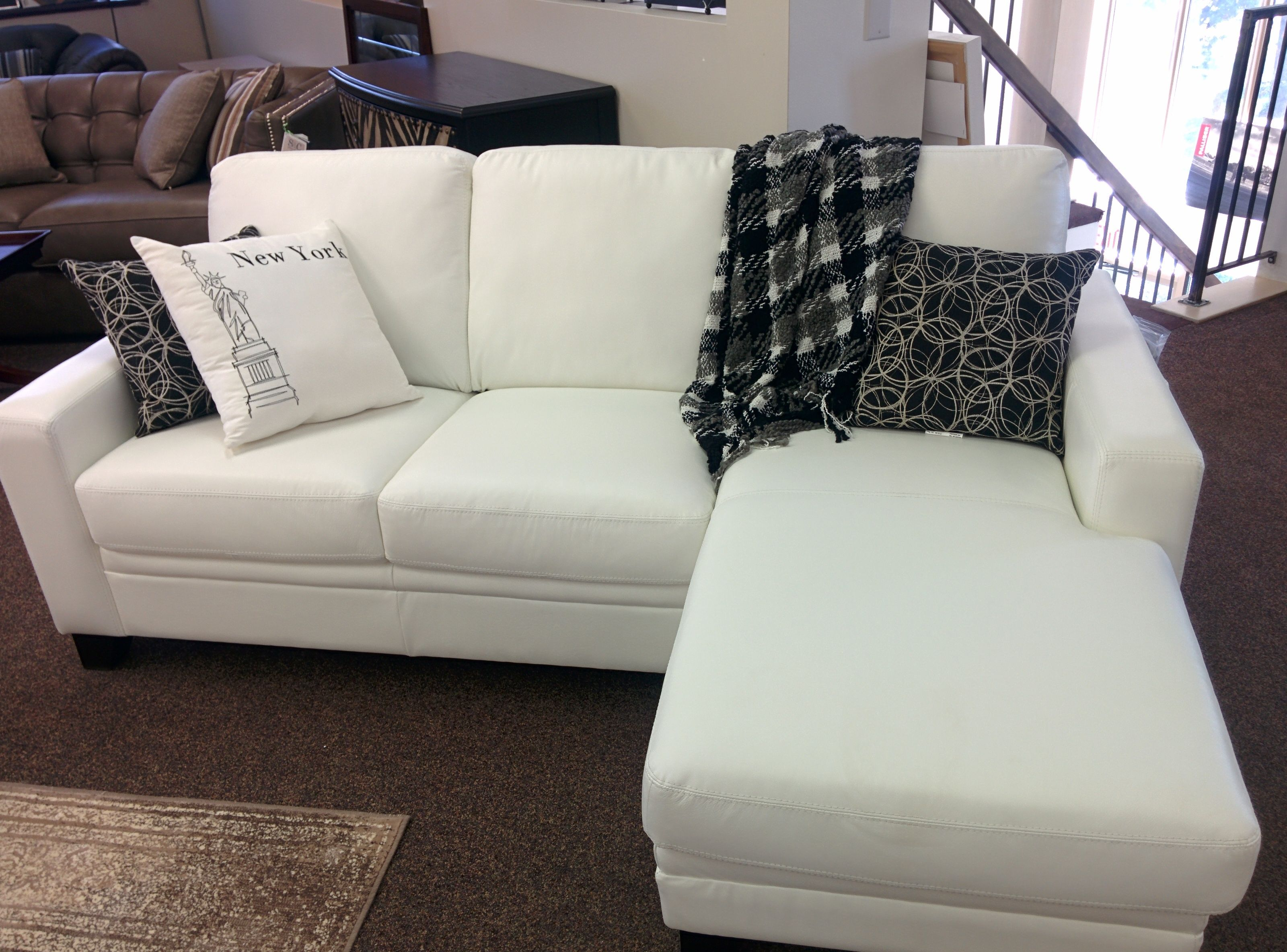 White leather sectional perfect for a condo or apartment