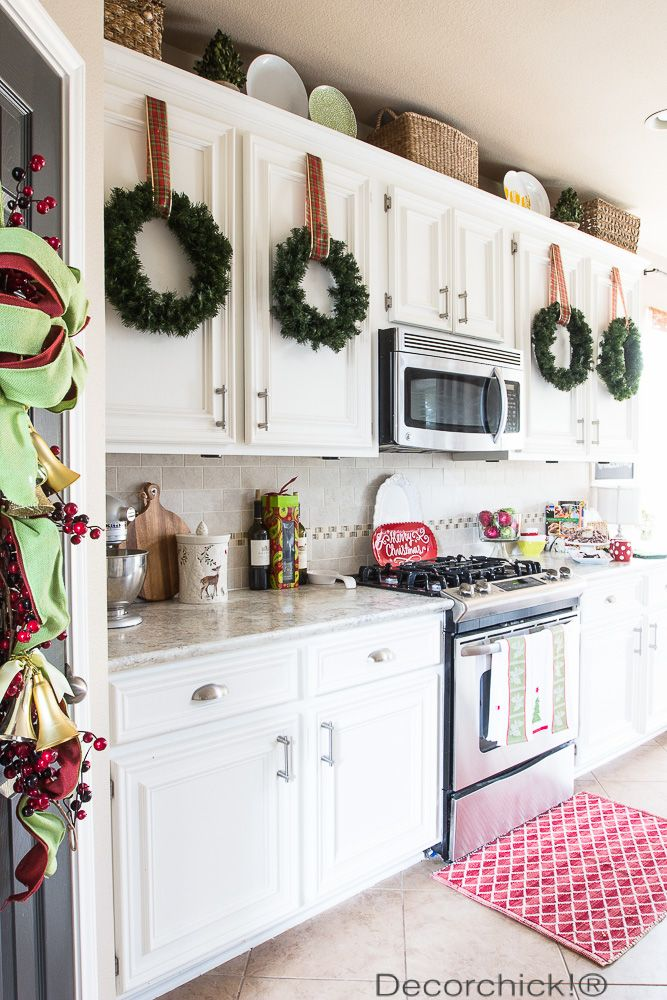 17 ways to decorate inside with christmas wreaths christmas decorations christmas kitchen on kitchen cabinets xmas decor id=12264