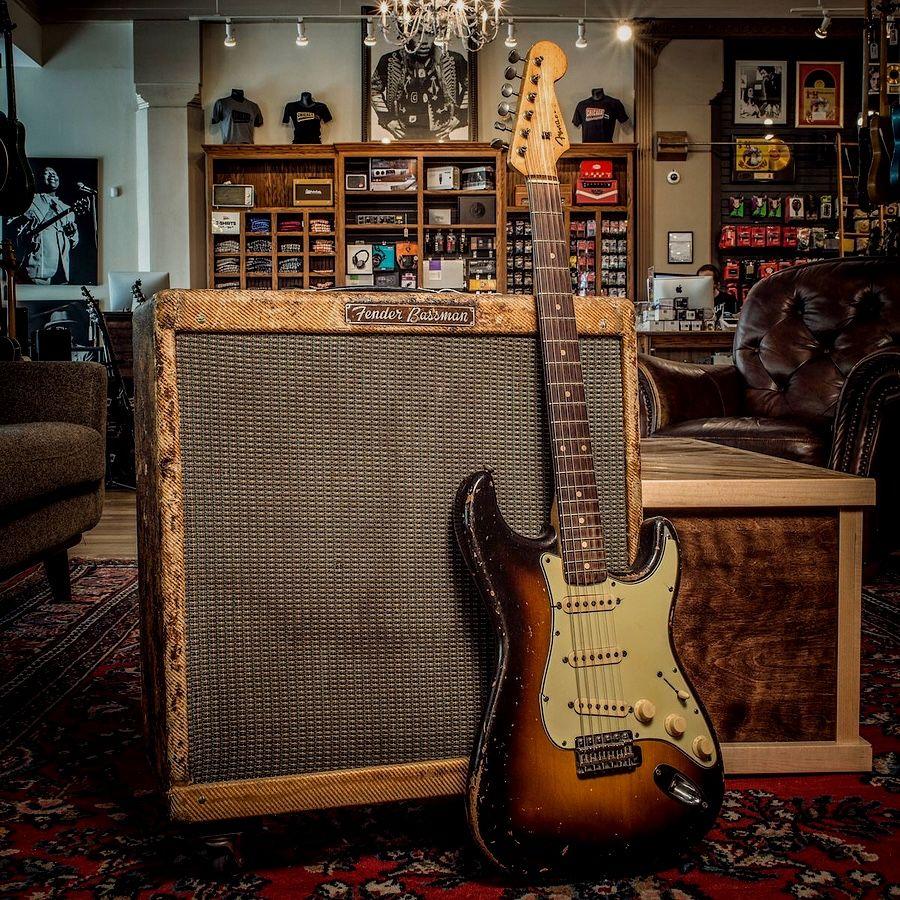 Old Fender Stratocaster and Fender amps in guitar shop