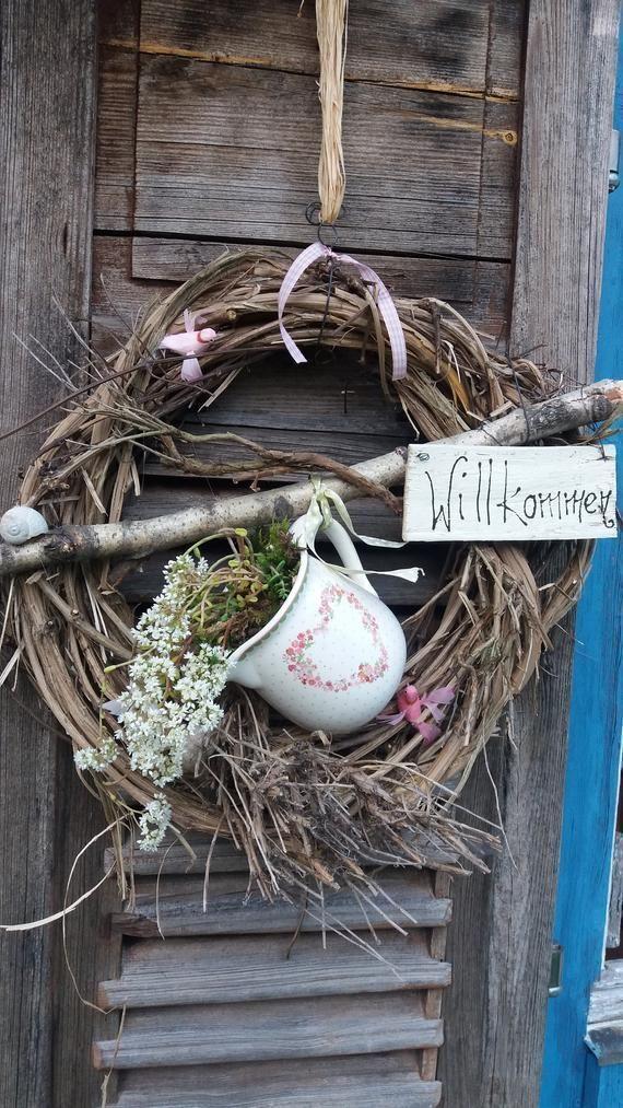 Handmade door wreath with a small porcelain jug and succulent plant ...,Handmade door wreath ...