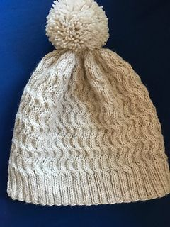 1e6c414826f This is the perfect hat for a snow day. It incorporates cable rounds with  relaxing knit rounds in between.