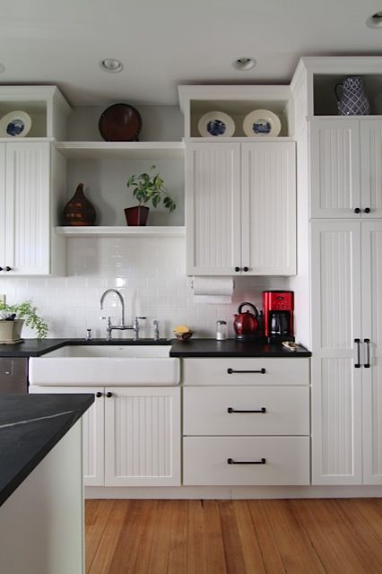 Design Sponge::boxes above cabinets, inexpensive way to ...
