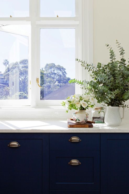 Butter Yellow Walls Paint Color Cobalt Blue Kitchen Cabinets Marble Countertops Picture Window