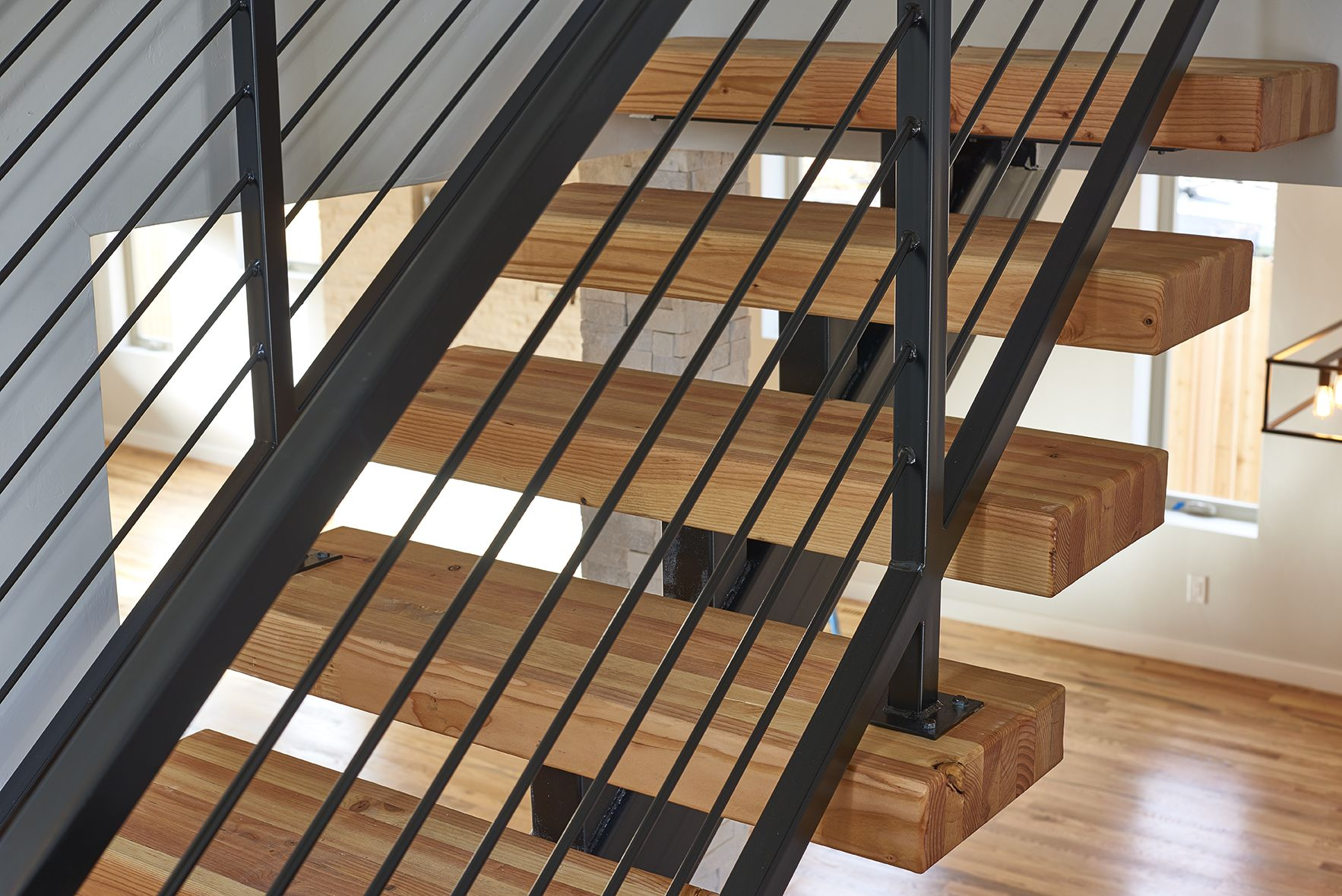 Butcher Block Stairs With Horizontal Wrought Iron Railings In