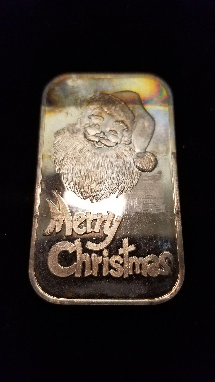 Christmas 1976-1  ounce 999 silver bar lot  #25