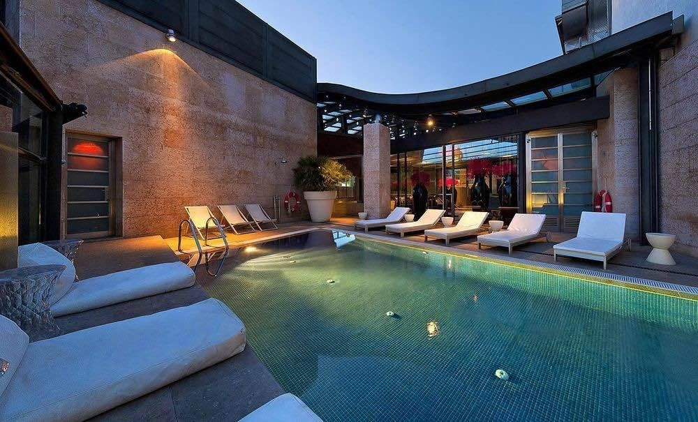 Rooftop pool of the urban hotel in madrid best rooftop - Luxury hotels in madrid with swimming pool ...