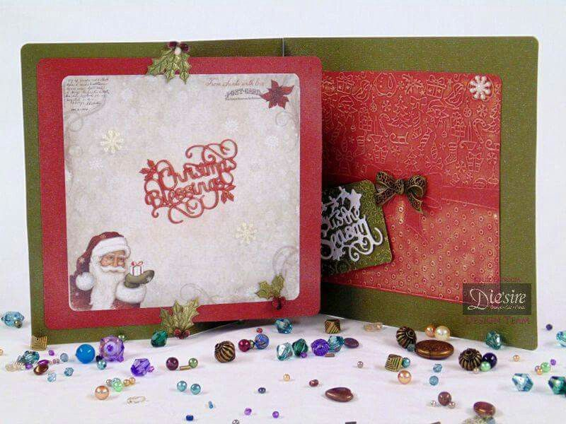 Kelly Patricia - 8x8 Trifold Card - Crafter's Companion: Die'sire Classiques Christmas Only Words 'Christmas Blessings' die - Die'sire Classiques Christmas Only Words 'Tis the Season' die - Die'sire Christmas Classiques 'Santa's Sleigh' die - Die'sire Christmas Classiques 'Poinsettia' - Red card: Core'dinations - Green card: Core'dinations - Spray & Sparkle Diamond pearl - Collall All purpose glue - #crafterscompanion #Christmas
