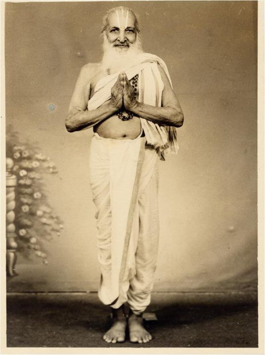 """Of Krishnamacharya's gesture: """"[Unlike Namaste, in] anjali mudra, the palms are not flat against each other; the knuckles at the base of the fingers are bent a little, creating a space between the palms and fingers of the two hands. When done properly, the shape of the anjali mudra resembles a flower bud that is yet to open, symbolizing the opening of our heart. This signifies the potential for and intention to progress toward greater spiritual awakening."""" —AG Mohan"""