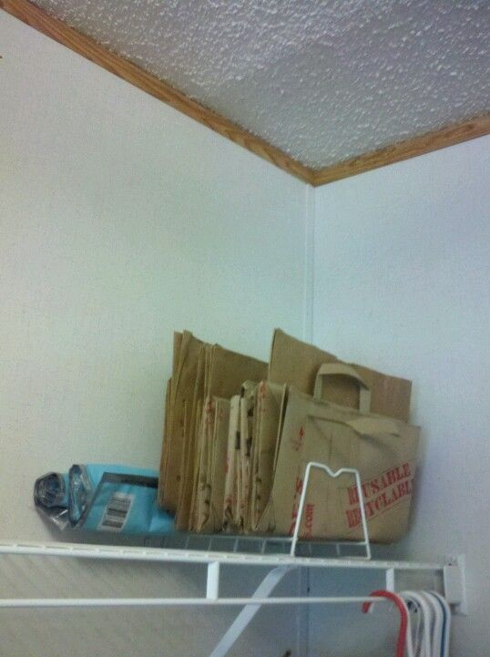 repurposing wire shelving | Paper bag storage repurposed a wire plate rack. | Organize & repurposing wire shelving | Paper bag storage repurposed a wire ...