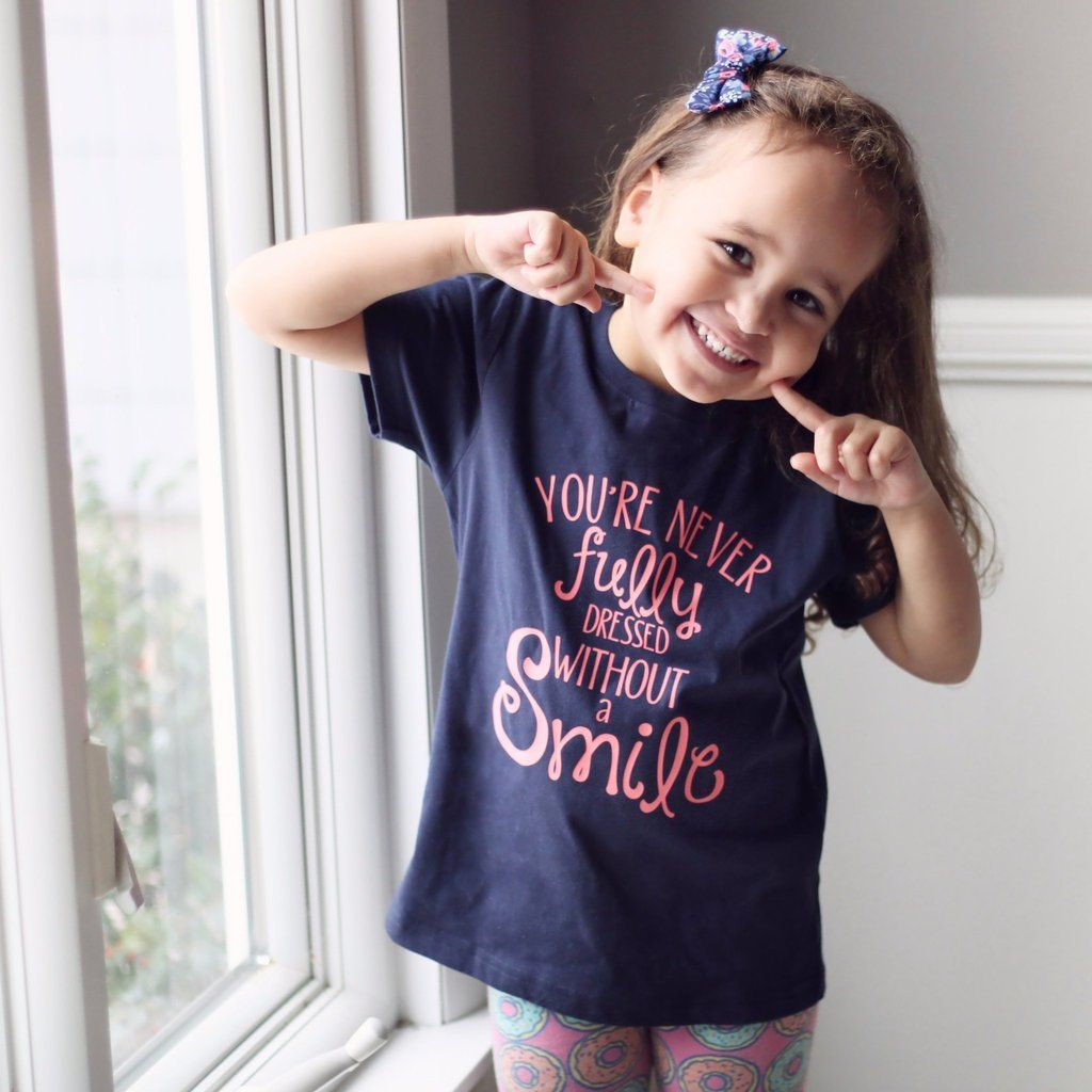You Re Never Fully Dressed Without A Smile Kids Tee Kid Tees Kids Fashion Unisex Fashion