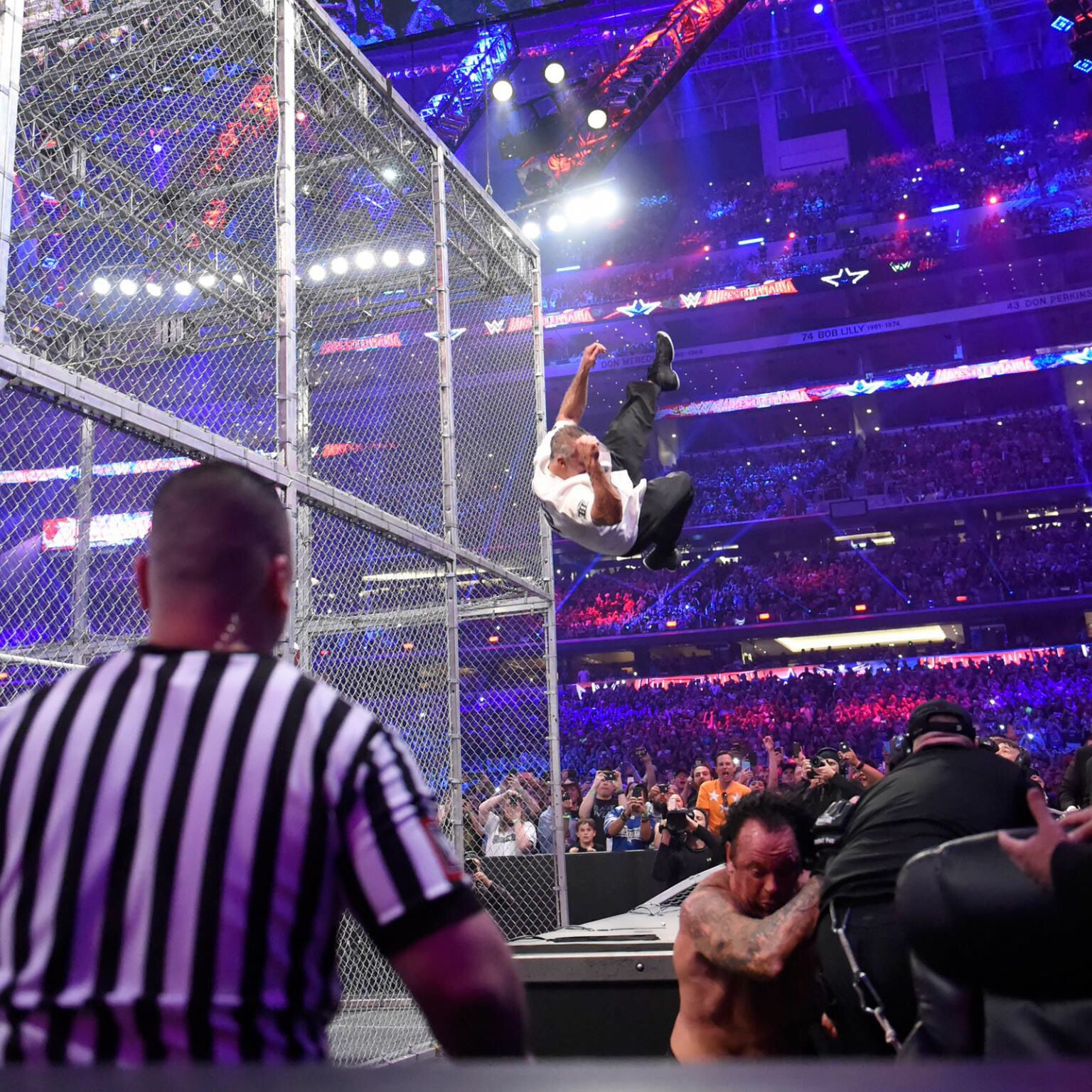 Undertaker gets out of Shane's trajectory!