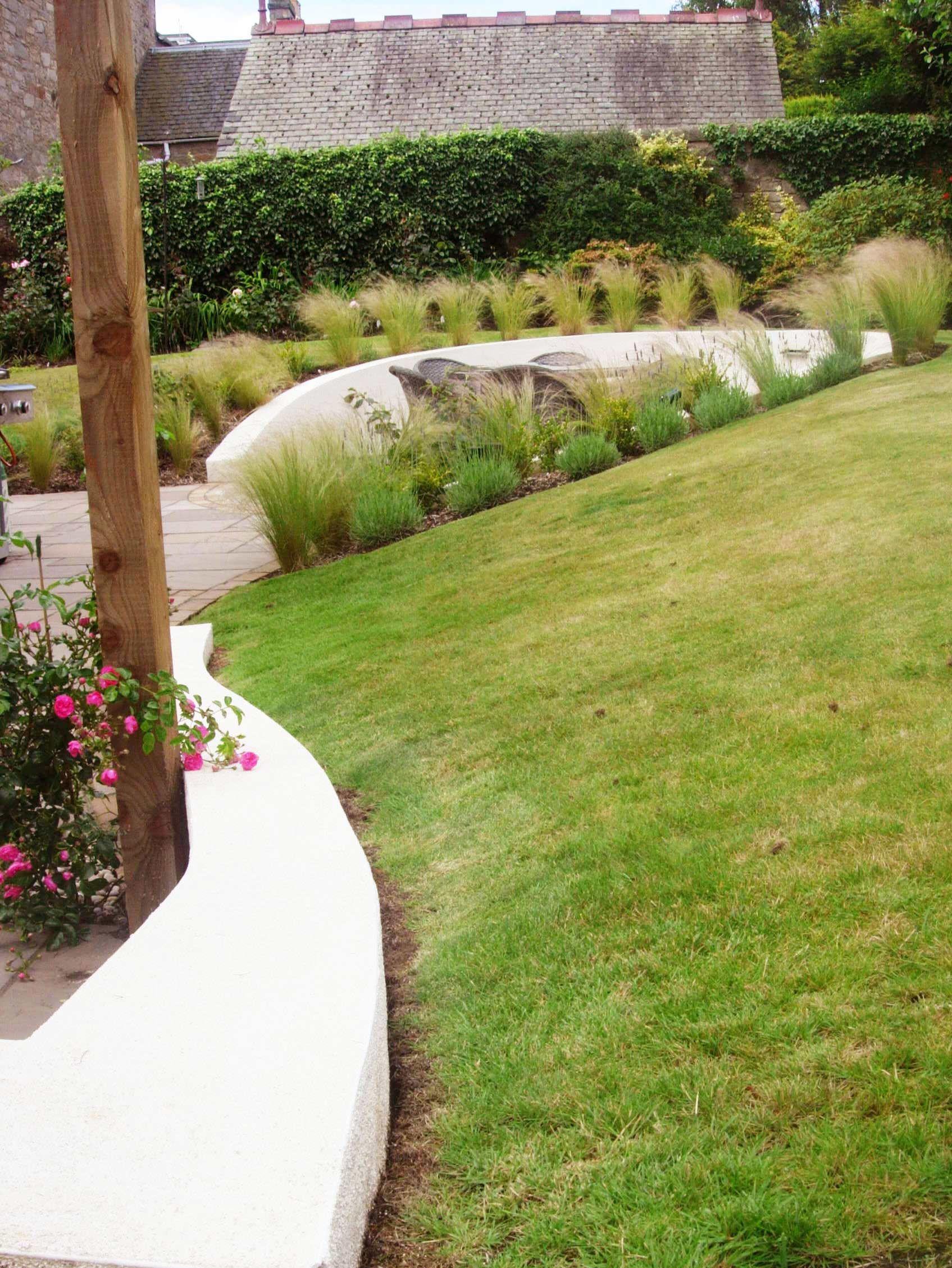 motif garden design edinburgh circular patio within grasses