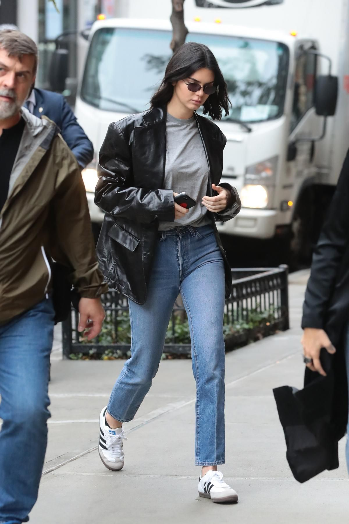 04ac38cb11cd Kendall Jenner wearing Adidas Samba Sneakers and R13 Fall 2017
