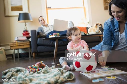 Young Family Playing And Relaxing In Living Room Young Family Room Living Room