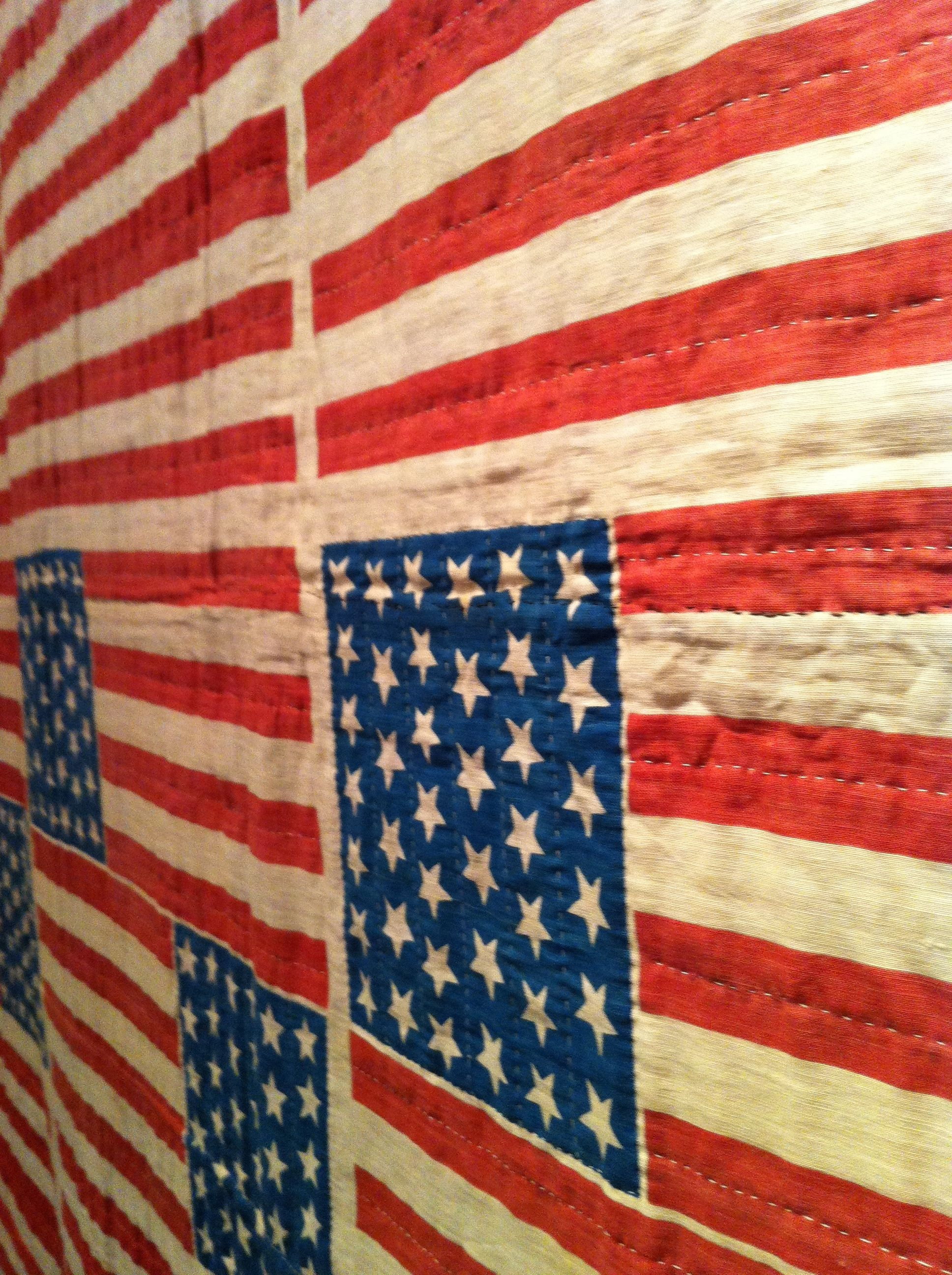 """""""Uncut 39- Star Flags Quilt """" 1889 . This quilt is made from 28 uncut 39-star flag . In anticipation of the Dakota joining as a single state in 1890, flag manufactures jumped the gun in producing flags with this star configuration. Four states actually joined the union in 1890 , bringing the number of states and stars to 43. at Frazier Musuem Loiusville KY"""