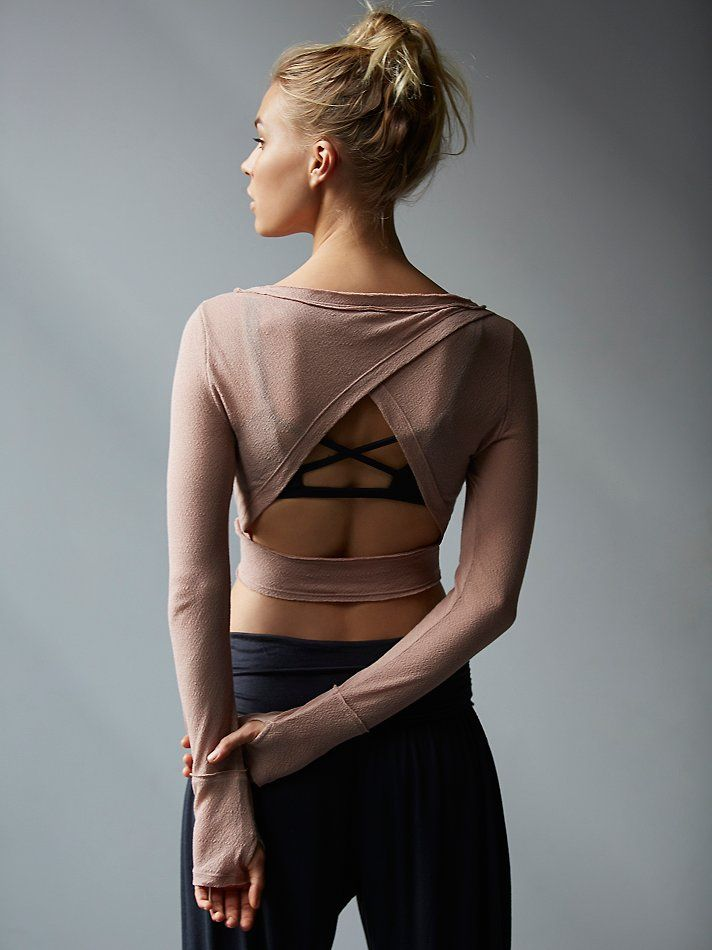 Battu Cover Up | Sheer cropped long sleeve studio top. Move freely with Picot Performance surplice cutout on back, raw seam detailing, and thumbholes.   *By FP Movement   *FP Movement is an entirely new activewear collection, designed to nourish your mind, body, and free spirit.
