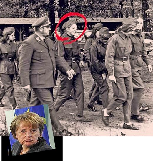 Angela Merkel walking next to a Deutsches Rotes Kreuz der DDR officer.
