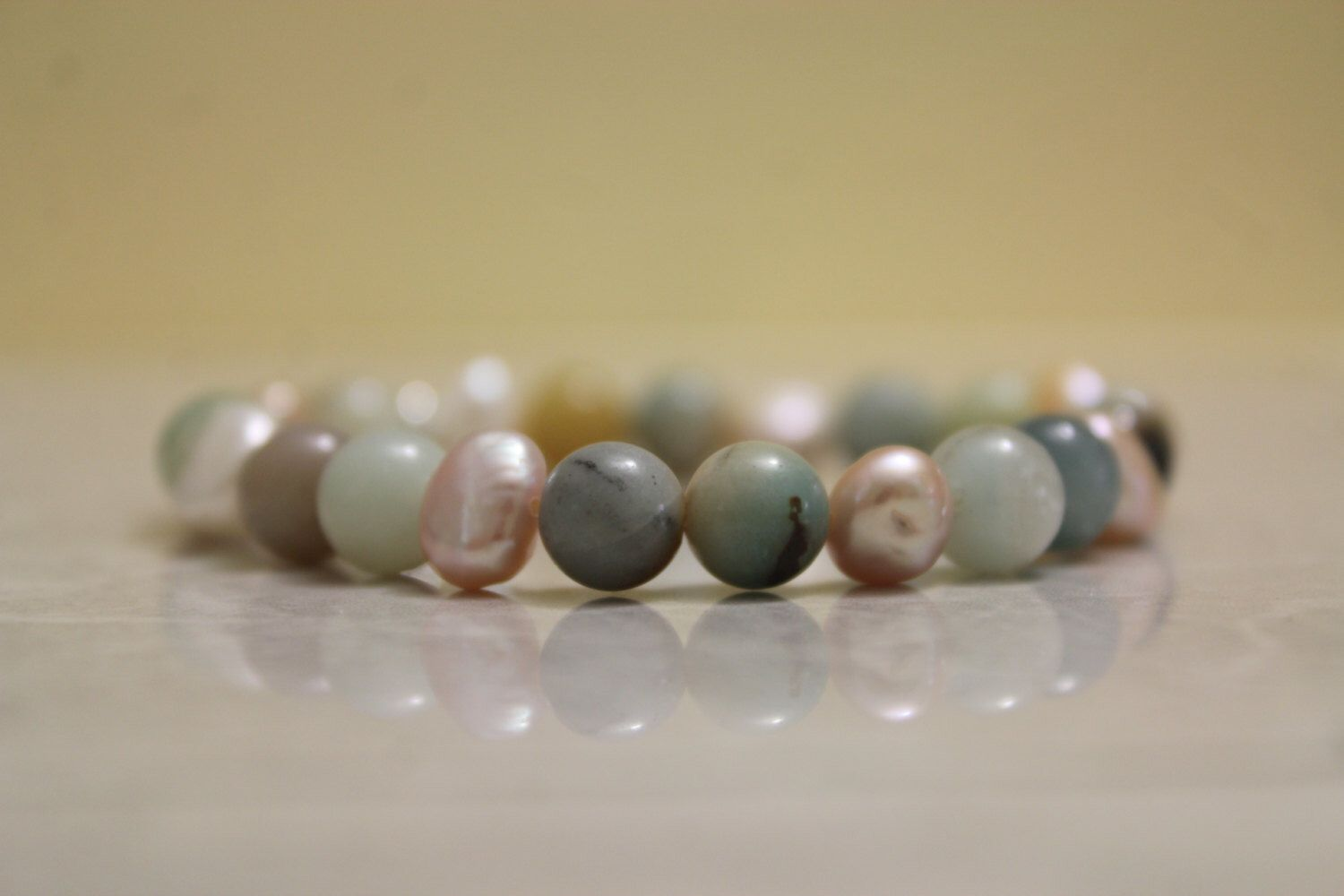 A personal favorite from my Etsy shop https://www.etsy.com/listing/262183258/amazonite-and-freshwater-pearl-bracelet