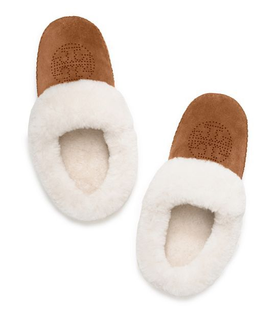 2a01dbff5a4 The Coley suede slipper from Tory Burch takes the off-duty wardrobe  essential to a whole new level of cozy chic.