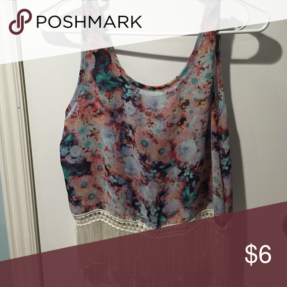 Crop top Very pretty floral print crop top with tassles on bottom. Size Medium. Never worn. Love blossom Tops Crop Tops