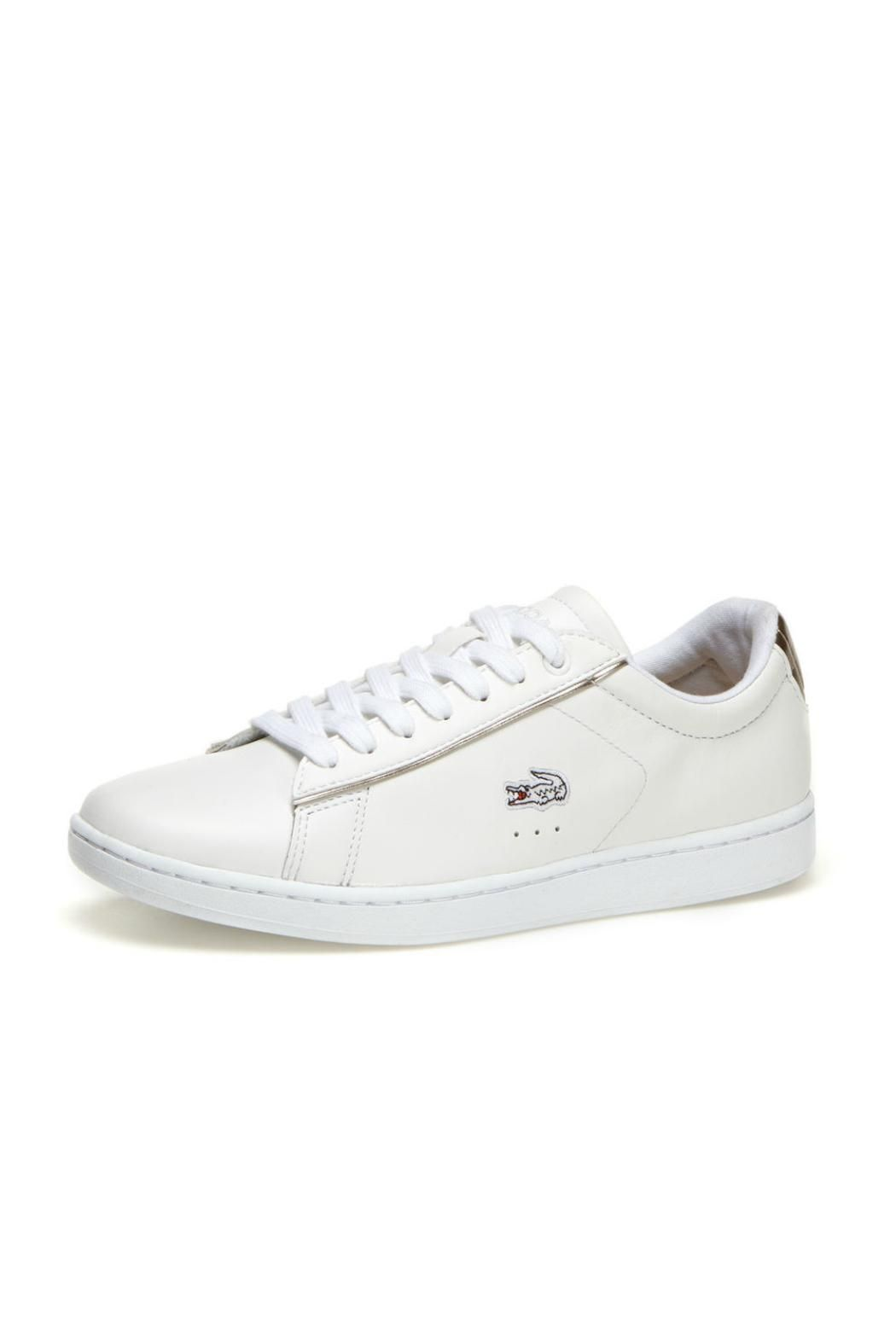 06d1da5b1 Embroidered with small crocodile logo. They are made with premium leather  and have a thick rubber sole. Carnaby Sneaker by Lacoste Footwear.