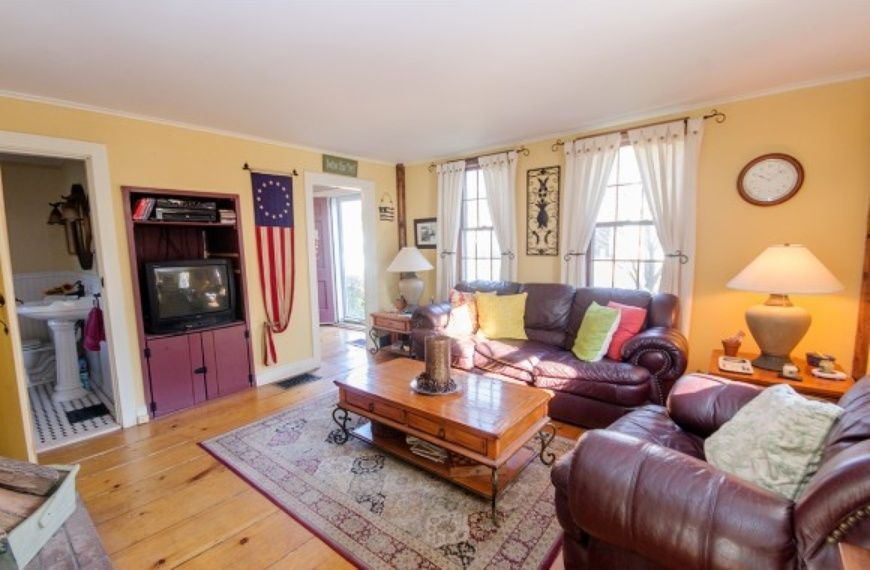 The perfect yellow living room..6 Bridge St, Salem, NH 03079 on Zillow