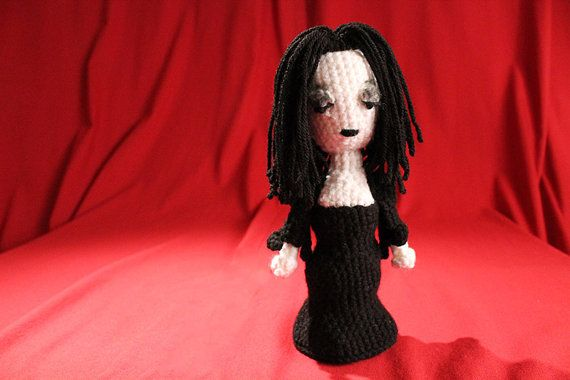 This original crochet pattern contains detailed instructions and more than 50 pictures to guide you through the creation of the darkly adorable Addams Family, featuring Gomez, Morticia, Pugsley, and Wednesday. Although I refer to the pattern as intermediate, in truth, there is nothing more complicated than a triple crochet going on here. Other required stitches include DC, HDC, and s2ctog, or a single crochet decrease. Color changes are required, but the number of changes isnt tedious.  When…