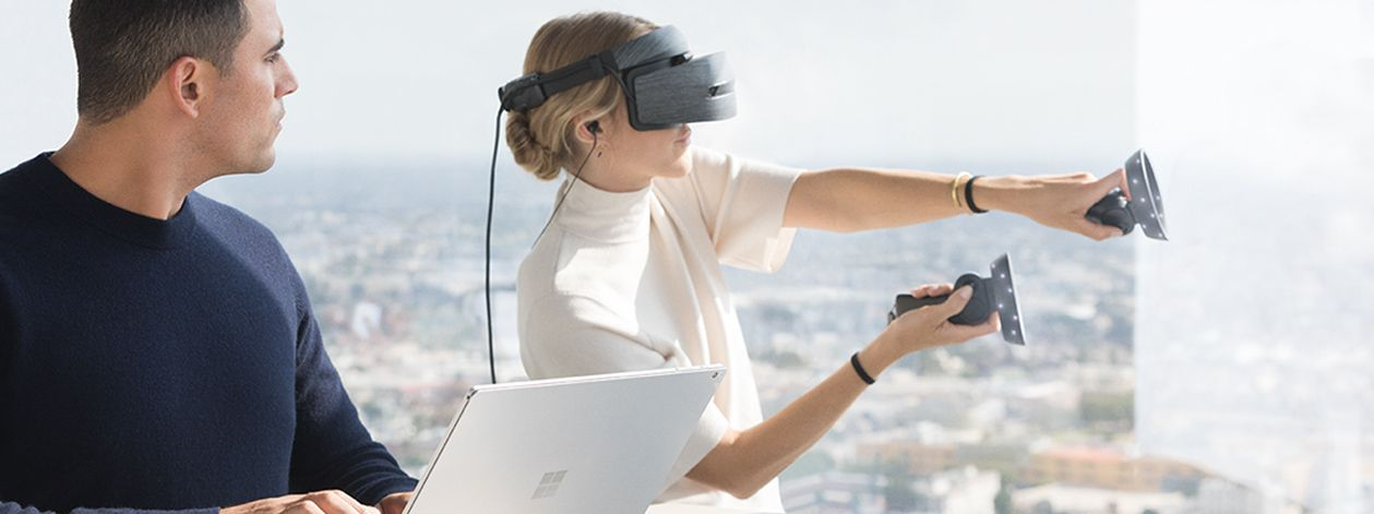 A Woman Using A Windows Mixed Reality Headset And Motion Controller Microsoft Virtual Reality Headset Windows 10
